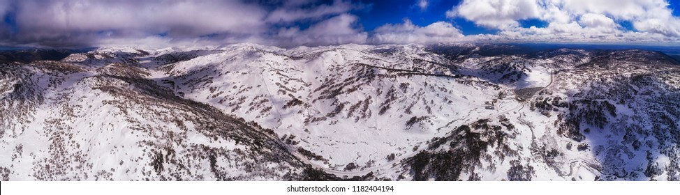 Snow covered Perisher valley town, ski resort and natural valley between mountain ranges in Snowy mountains national park of Australia in winter.
