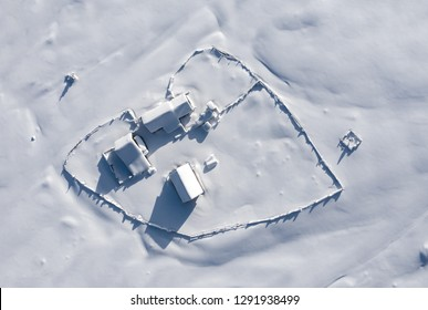 Snow covered remote, heart shaped homestead in the mountains. Aerial drone above view