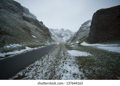 snow covered road heading up winnats pass in the peak district