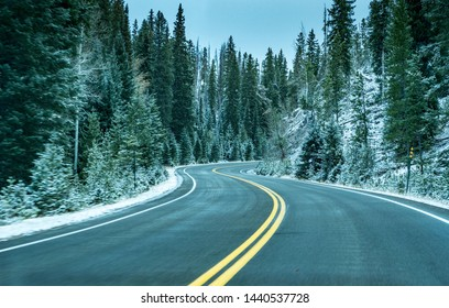 Snow covered road in the Rocky Mountains