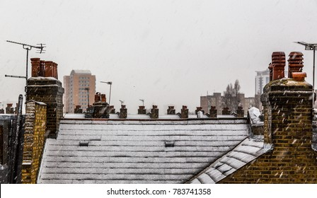 snow covered roofs of London Victorian houses in Battersea on a winter day