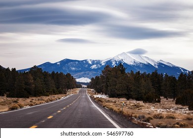 Snow covered San Francisco Peak, flagstaff Arizona with lenticular clouds.
