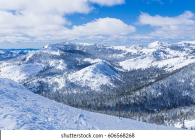 Snow covered slopes of the Sierra Nevada mountains in Lake Tahoe near a ski resort in winter