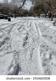 a snow covered street in Austin Texas in February
