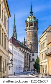 Snow Covered Street Shops Restaurants All Saints Castle Castle Church Schlosskirche Lutherstadt Wittenberg Germany. Where Luther posted 95 thesis 1517 starting Protestant Reformation.