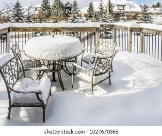 Snow covered suburban patio
