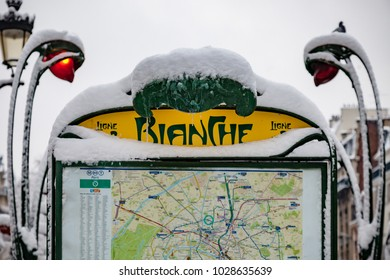 Snow covered subway entrance Blanche in Paris