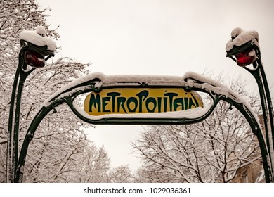 Snow covered subway entrance Metropolitain in Paris France