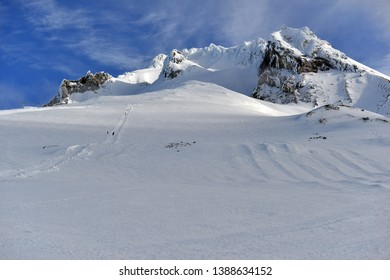 Snow covered terrain on Mount Hood, a volcano in the Cascade Mountains in Oregon popular for hiking, climbing, snowboarding and skiing, despite risks of avalanche, crevasses and weather on the peak.