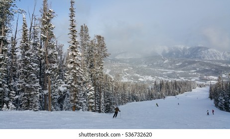 Snow covered trees and slopes in Big Sky Montana