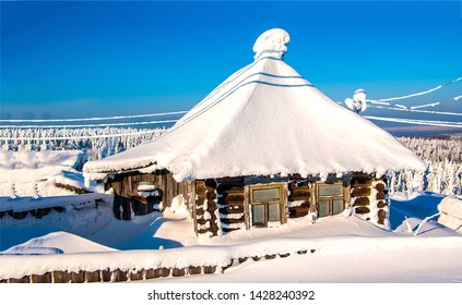 Snow covered village house in winter scene. Snow covered village hut in winter. Winter snow covered village hut. Winter snow covered village hut landscape