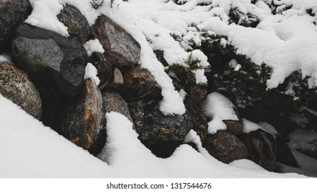 Snow covered wall of rocks