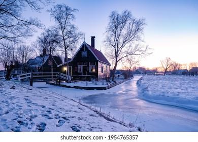 snow covered windmill village in the Zaanse Schans Netherlands, historical wooden windmills in winter Zaanse Schans Holland during winter