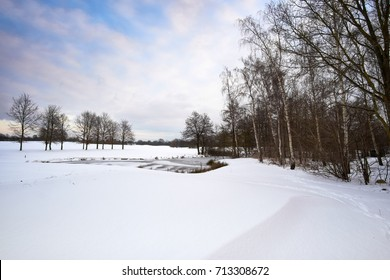 Snow covered winter landscape on birkeroed golf course in Denmark