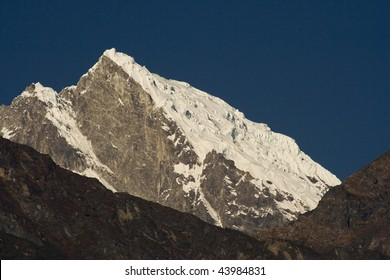 Snow covering the summit of Khatang in Nepal