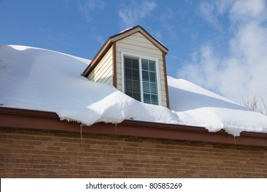 Snow drifted on roof of a home