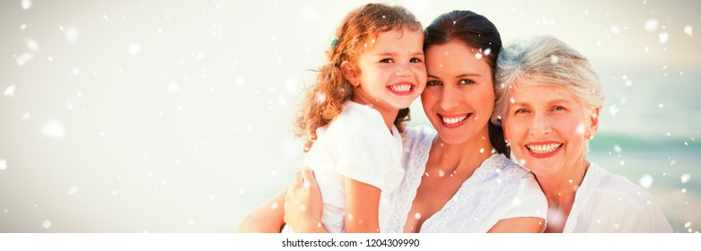Snow falling against portrait of cheerful family