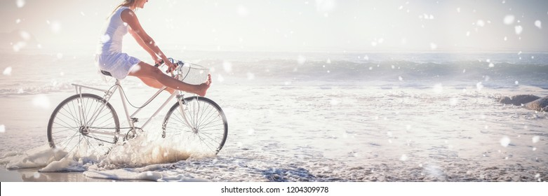 Snow falling against woman riding bike