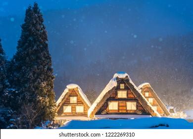 Snow falling on light Up Festival in winter at shirakawago Gifu Chubu Japan.
