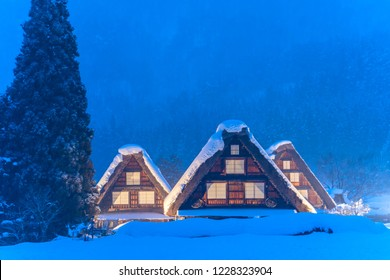 Snow falling on light Up Festival in winter at shirakawago Gifu Chubu Japan.