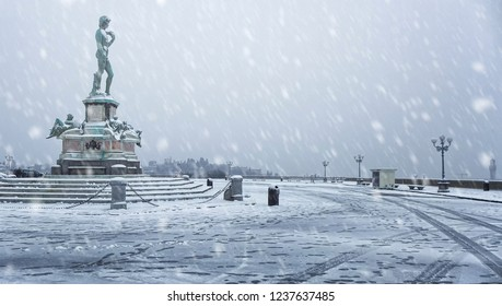 """Snow falling over """"Piazzale Michelangelo"""" (Michelangelo's Square) and the replica of David statue, in Florence (Italy). Winter snowfall."""