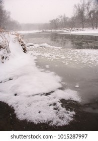 Snow falls along the Kishwaukee River on a cold winter morning at Blackhawk Springs Forest Preserve in northern Illinois