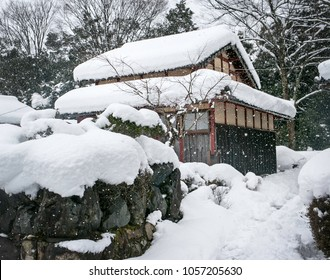 Snow falls on an old Japanese house in Shiga Prefecture