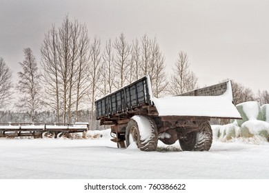 The snow fell over the fields very suddenly this year. The farming machinery was covered with heaps of snow in the Northern Finland.