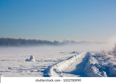 Snow field with fog on sunny winter day.