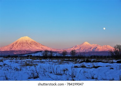 snow field with volcano background