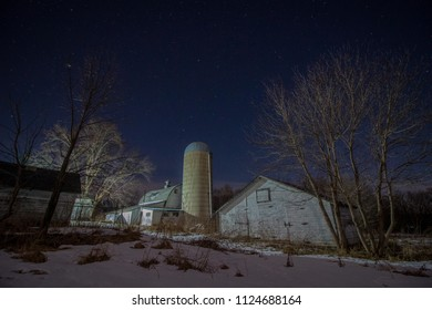 Snow fields and barn