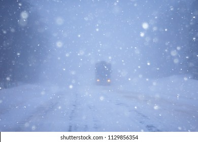 snow and fog on the winter road landscape / view of the seasonal weather a dangerous road, a winter lonely landscape - Shutterstock ID 1129856354