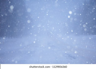 snow and fog on the winter road landscape / view of the seasonal weather a dangerous road, a winter lonely landscape - Shutterstock ID 1129856360