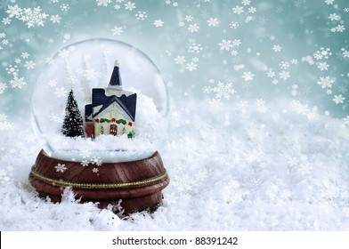 Snow Globe With Church And Christmas Trees Inside Copy Space Available Shallow Depth Of