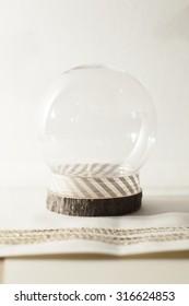 snow globe on cream background