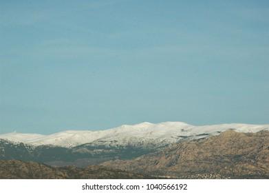 Snow the Guadarrama mountain range in Madrid (Spain) with La Pedriza on the front.