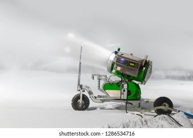 Snow gun in ski slope on blurred background