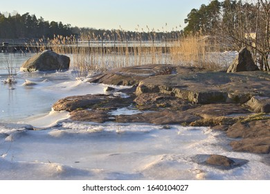 Snow has melted on the rock and heat of the sun has shaped surface of ice