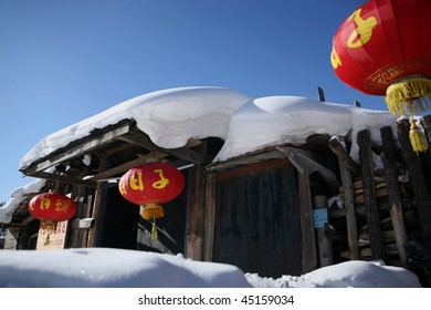 Snow house with red lanterns. The Chinese words on lanterns mean HAPPY LIFE.