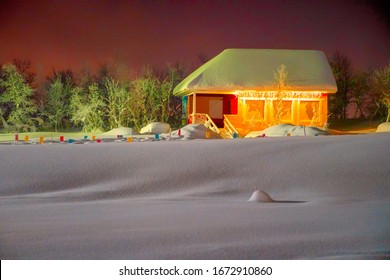 Snow house in winter night and a lot of snow on roof and front