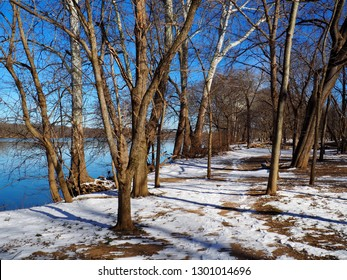 Snow/ ice/ frost trail in Algonkian Regional Park, Sterling, Loudoun County, Virginia with Potomac River view during winter time - day light and blue sky