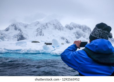 Snow, ice, glaciers, ocean water, clouds, seals and penguins - a typical sightseeing day for tourism in Antarctica