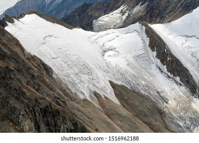 Snow and ice on the mountain tops above Kaskawulsh Glacier in Kluane National Park, Yukon, Canada