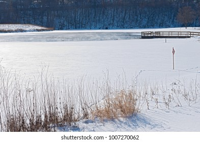 snow ice and open water of lake rebecca park in hastings minnesota