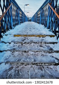 Snow and ice over a railway footbridge in southern England