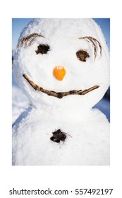 Snow, icy temperatures and gloriously blue sky invited me to a long walk. Thereby I seen this funny snowman.