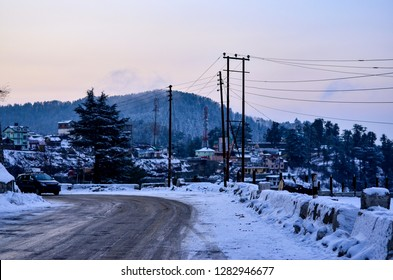 A snow laden road after recent snowfall in Kufri, Shimla, Himachal Pradesh, India. It is a popular winter tourist destination for enjoying snowfall and skiing.