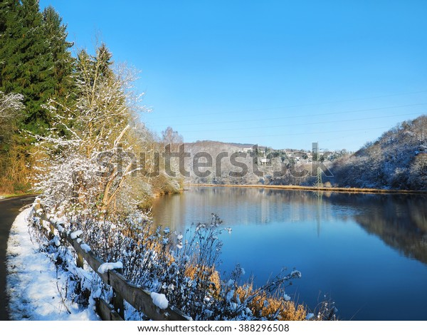 Snow and lake  landscape in Eifel National Park Germany