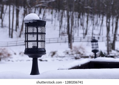 Snow lantern on the background of a winter landscape. Winter landscape with lantern. Winter background.