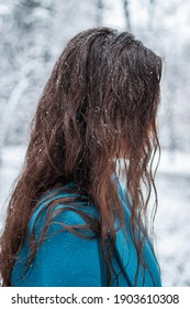 Snow lover. Snowflakes in the hair. Enjoying the snowy day.